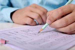 Young man taking an exam, close up photograph.