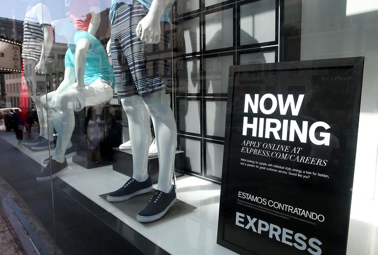 now hiring sign in Express store window