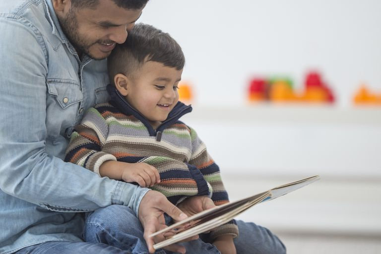 Father Reading His Son a Book
