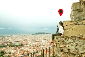 A woman checks her GPS signal in Barcelona