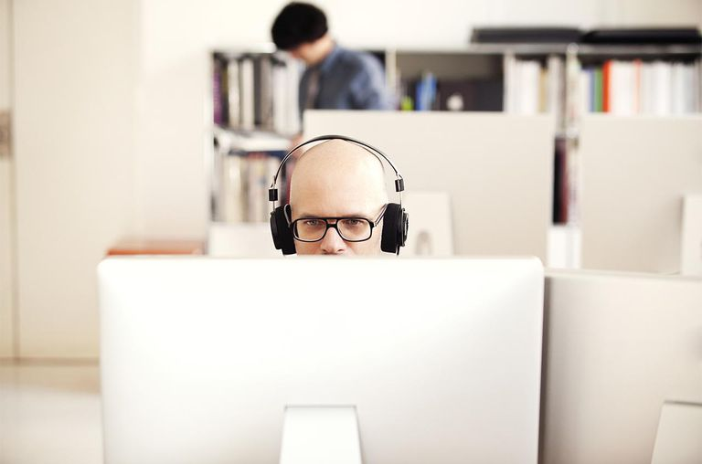 Man with headphones at computer