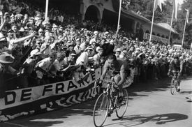 Crowd cheering for bikers during Tour De France.