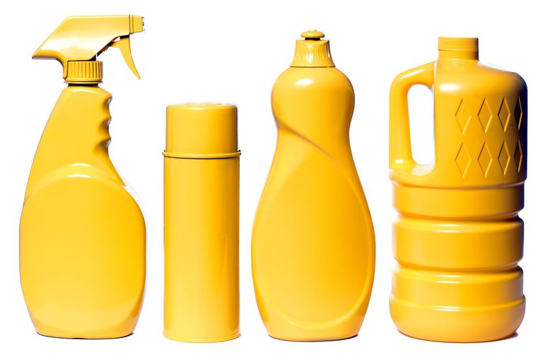 Yellow bottles of household cleaners, like toilet bowl and window cleaners with ammonia and bleach