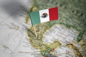 Mexican flag stuck into the map of Mexico