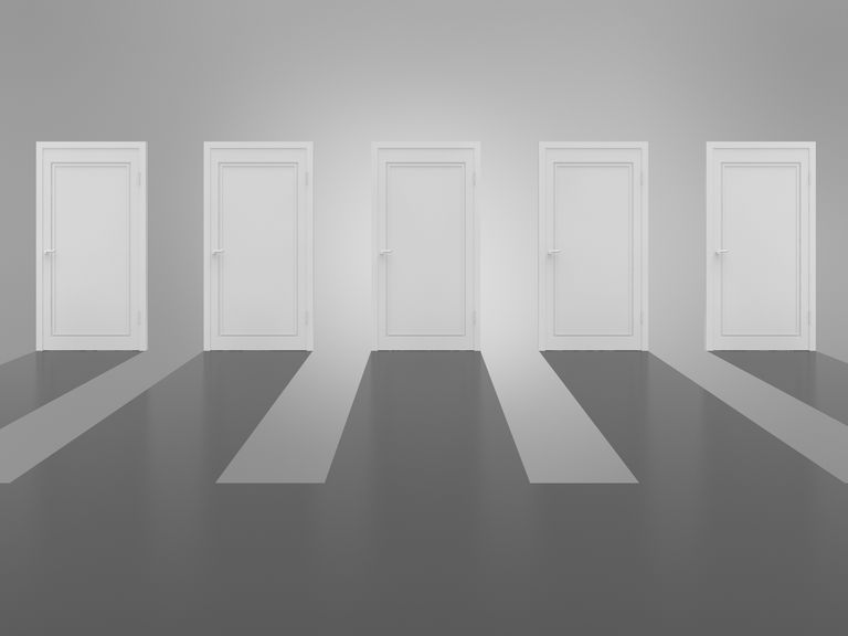 Five white doors in a row, representing five options in the decision-making process