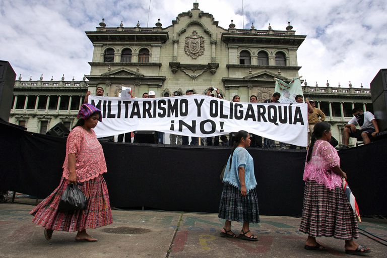 "The banner reads ""No to militarism and oligarchy"""