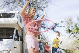 Family using hula hoops with RV