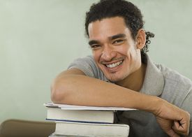 Student-with-books-by-Tetra-Images-Getty-Images-79253230.jpg