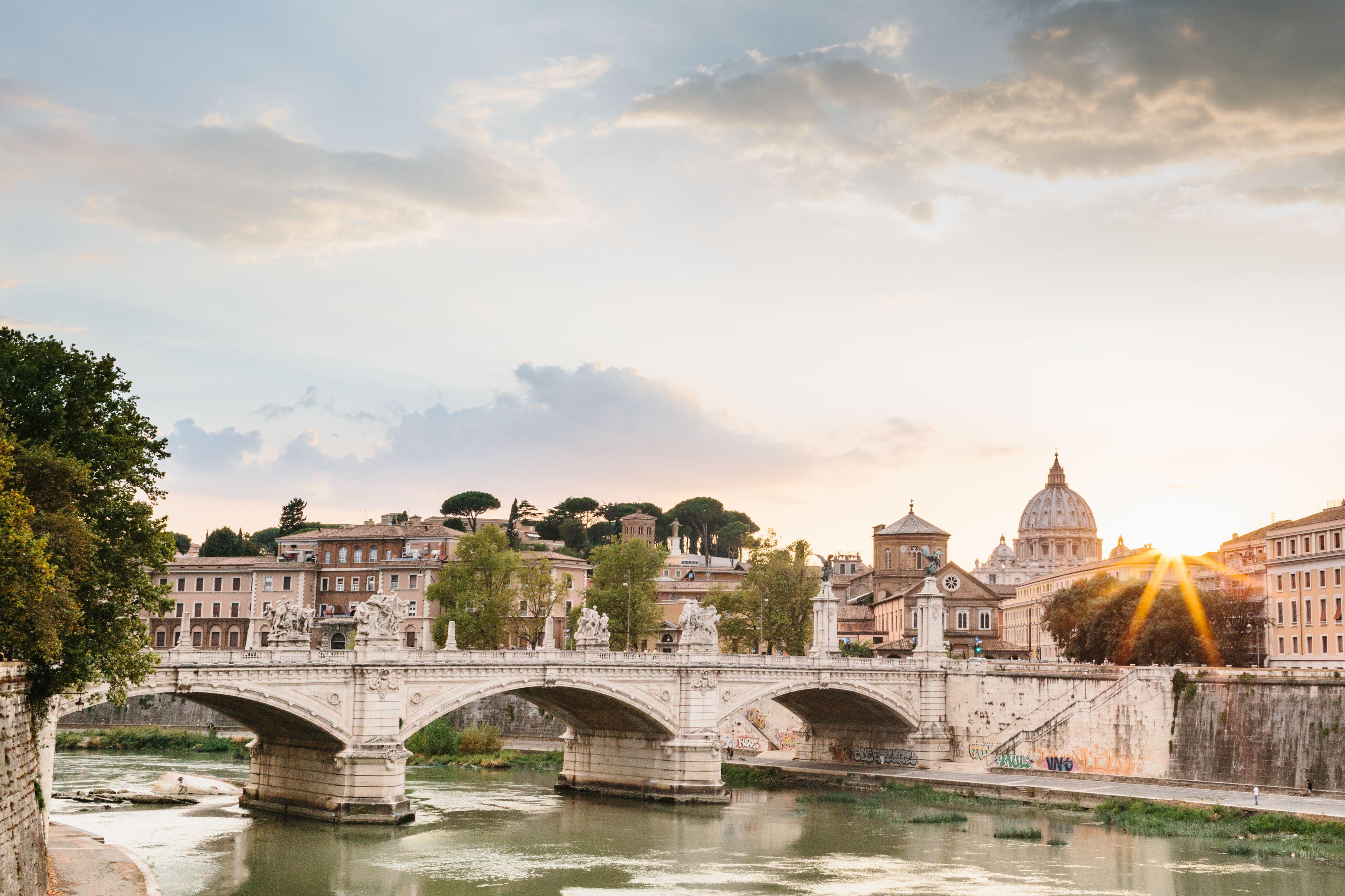 Sunset over the River Tiber with a view of Vatican City