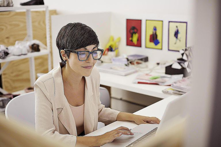 Creative businesswoman typing on laptop