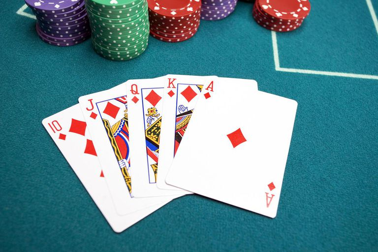 Royal flush with poker chips