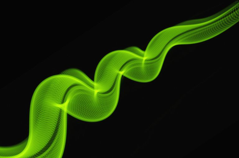 Swirling green light against black background.