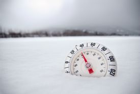 Thermometer in Desolate Winter Snow Tundra