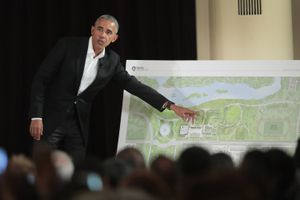 ex-president Obama gesturing to a map in front of a seated audience