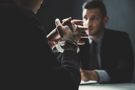 Man with handcuffs in interrogation