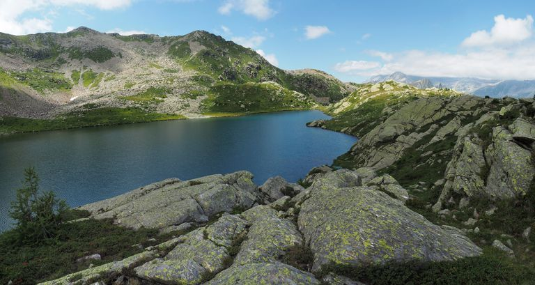 Alpine Lake Tschawinersee Surrounded By Granite Boulders