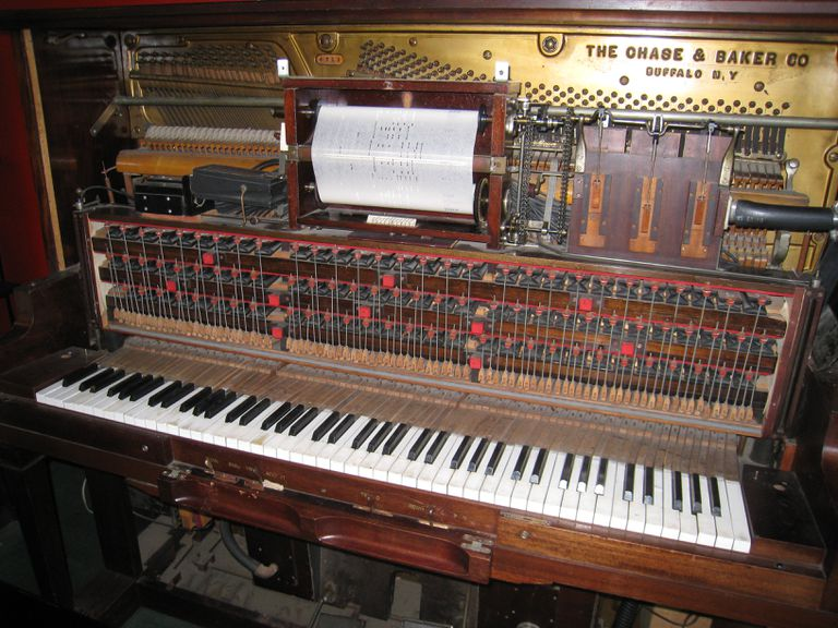 Player piano with roller mechanism.