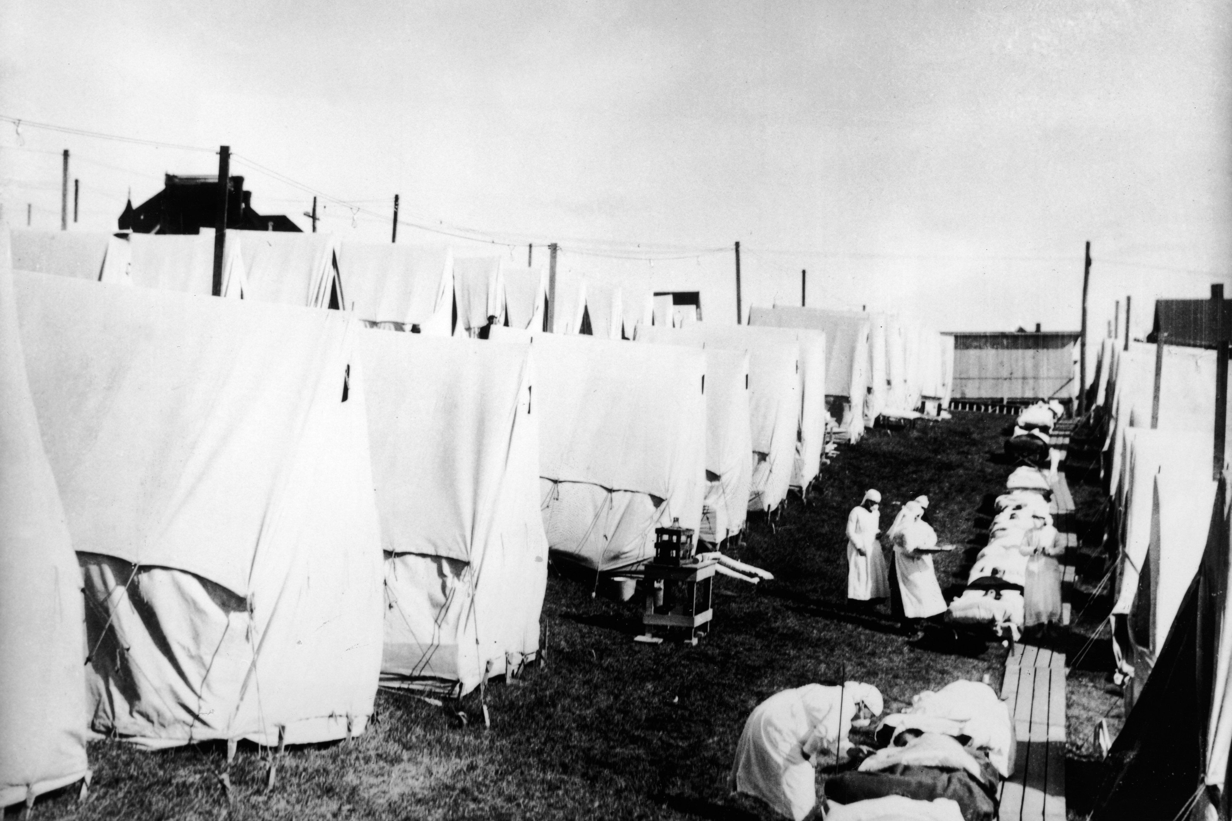 During the 1918 Spanish Flu Pandemic U.S. Army Base Hospital, Camp Beauregard, Louisiana. Tents for influenza patients.