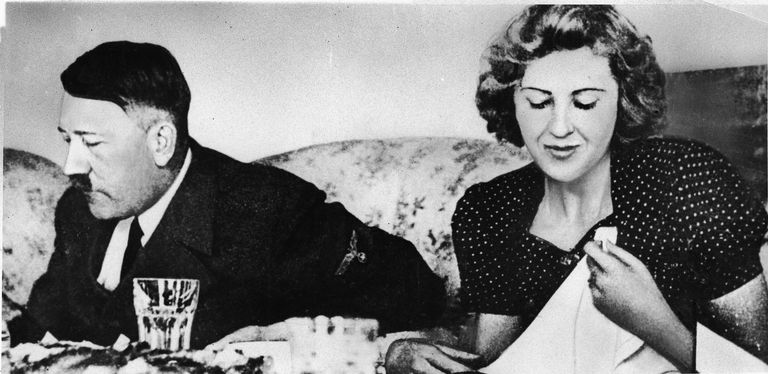 A picture of Nazi leader Adolf Hitler eating with mistress Eva Braun.