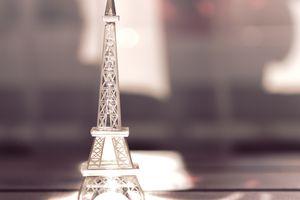 Miniature Eiffel Tower sitting in the sunlight.
