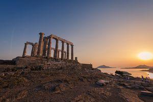 Temple Of Poseidon at sunset in Sounio cape in Attica region, Greece