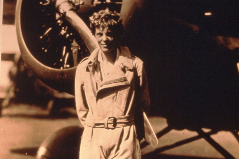 Amelia Earhart and her plane