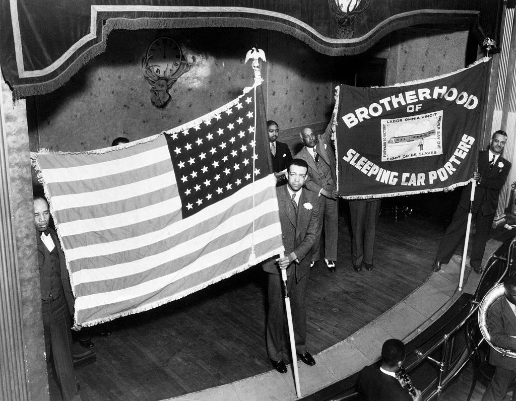 A. Philip Randolph holds Brotherhood of Sleeping Car Porters Union banner