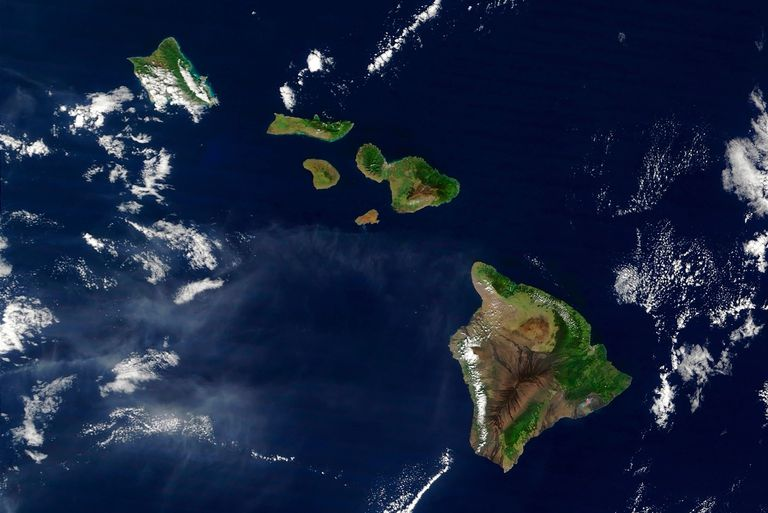 Hawaii as seen from a satellite in striking greens and blues