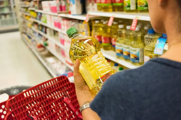 Woman shopping for vegetable oil