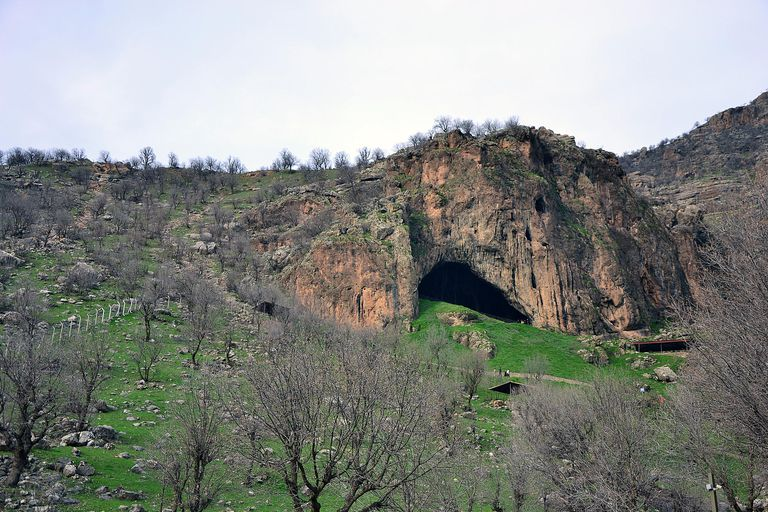Shanidar Cave against cloudy sky.