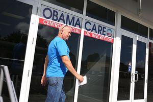 Man walking by Obamacare center in Florida