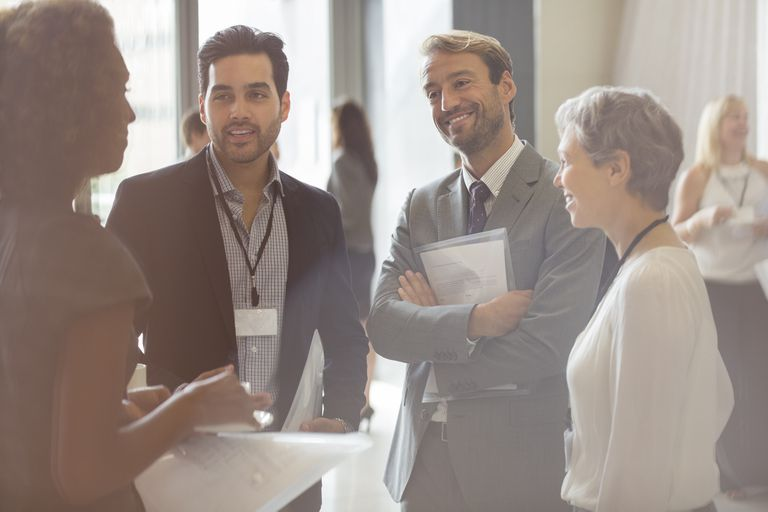 Group of business people smiling and discussing in office