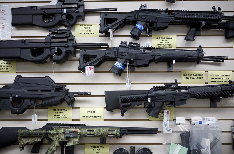 Semi-automatic weapons for sale are on display at Texas Gun