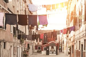 Laundry hanging from apartment buildings in Venice