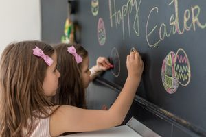 Children decorating a chalkboard for Easter similar to an Easter font