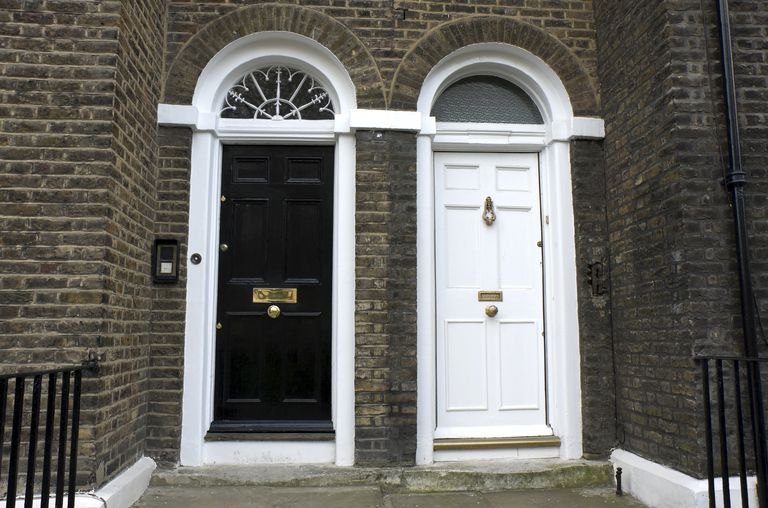 One black door next to one white door