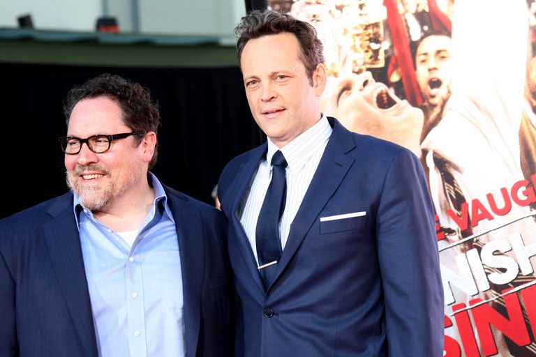 Jon Favreau and Vince Vaughn pose for cameras at a promotional event.