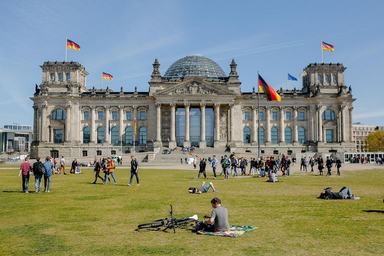People gather outside the Reichstag in Berlin, home of the Bundestag, the German parliament