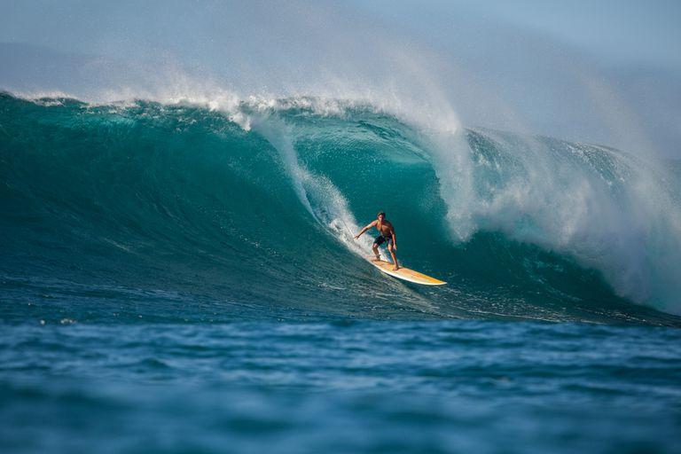 A man surfing in Hawaii