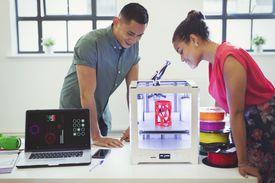 Designers watching 3D printer