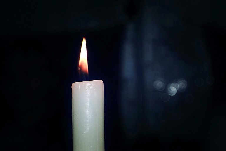 A lit candle with a calm flame