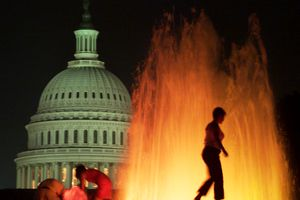 Woman walks on fountain near U.S. Capitol