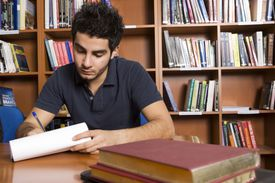 A male student studying in the library