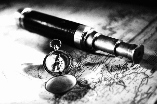 Oceanography - Spyglass and Compass on a Nautical Chart