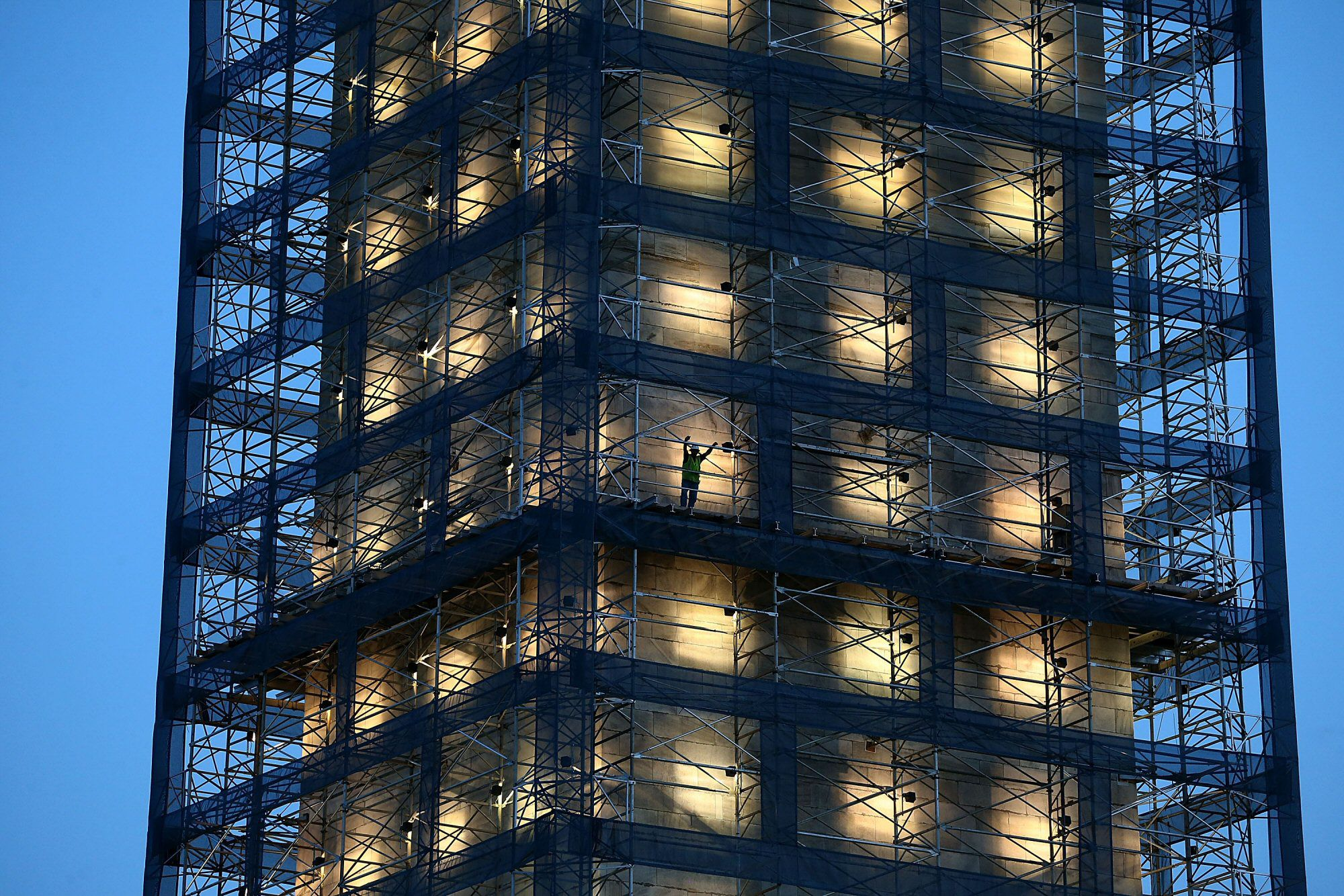 Worker on Washington Monument scaffolding, illumination designed by Michael Graves, July 8, 2013