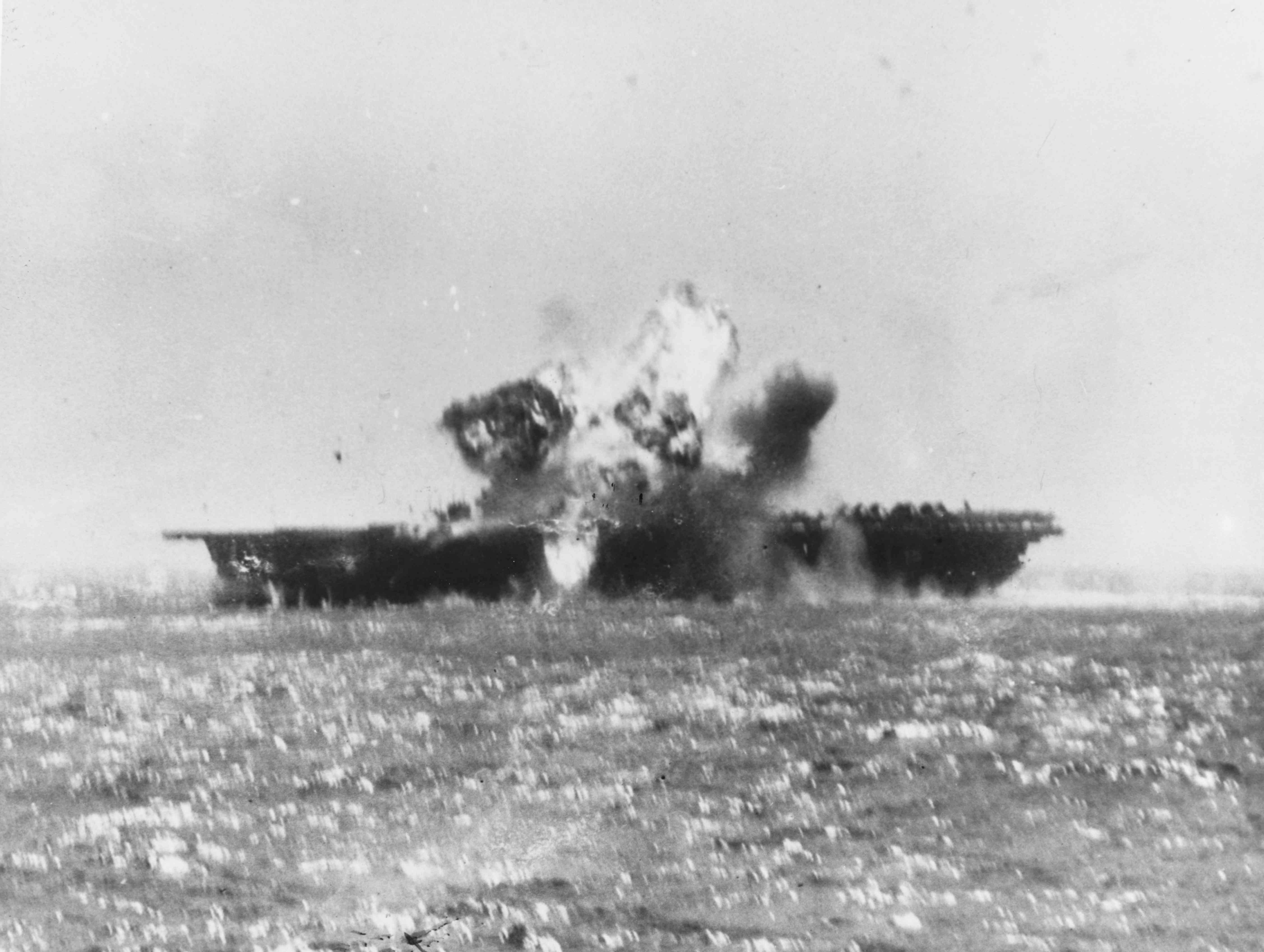Photo of USS Essex being hit by a kamikaze.