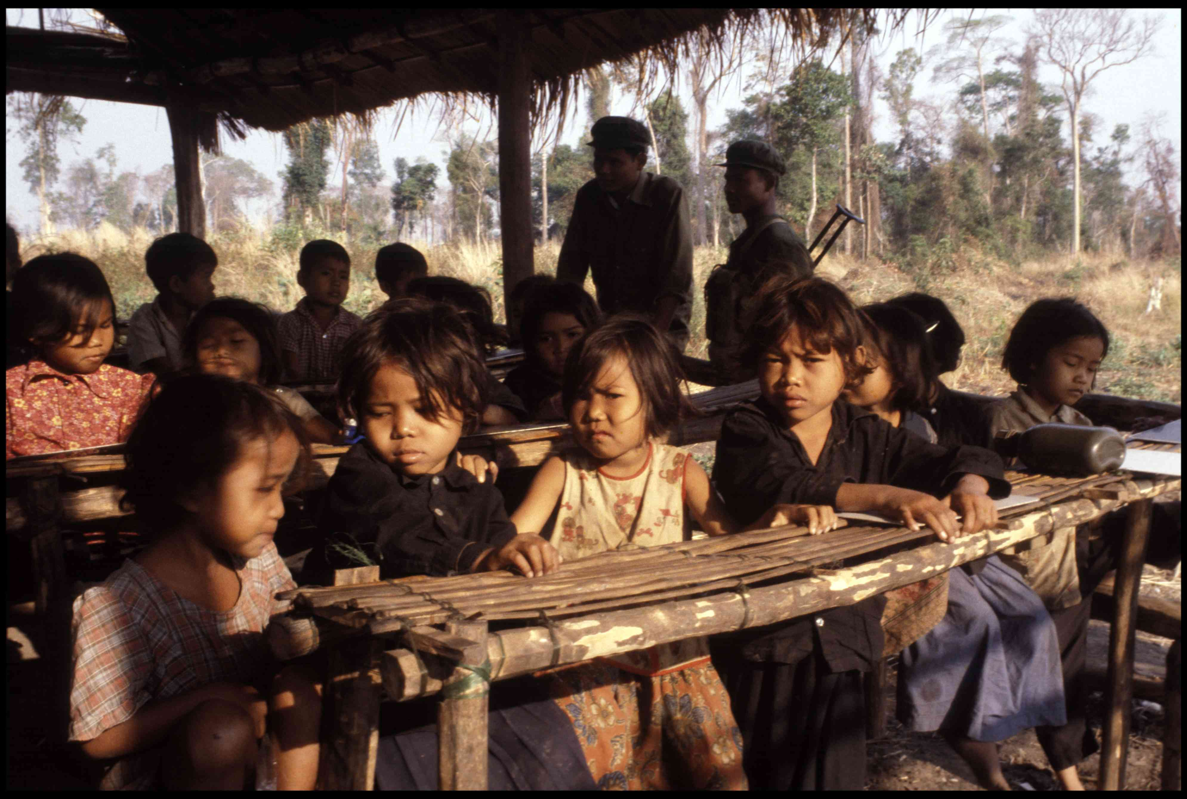 Children of Khmer Rouge guerrillas attend a make-shift school in western Cambodia, 1981