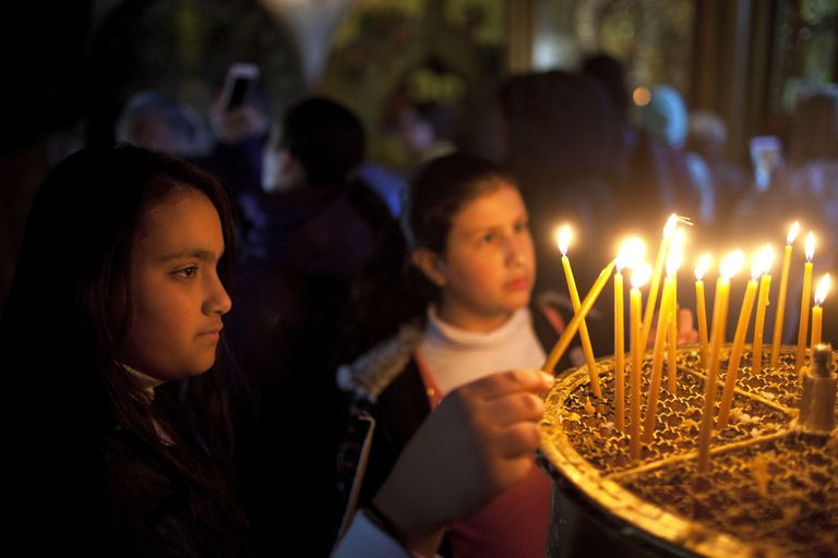 Children Light Candles at the Church of the Nativity