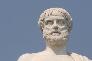 Aristotle statue against a blue sky.