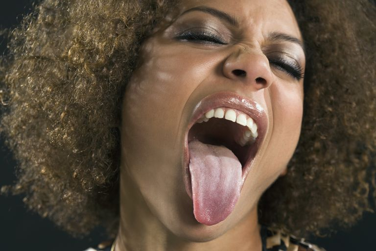 Woman sticking out tongue.